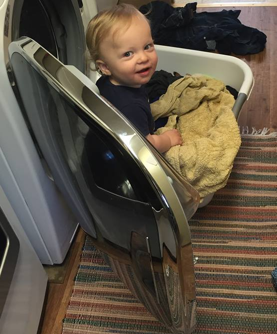 My nephew helping with laundry