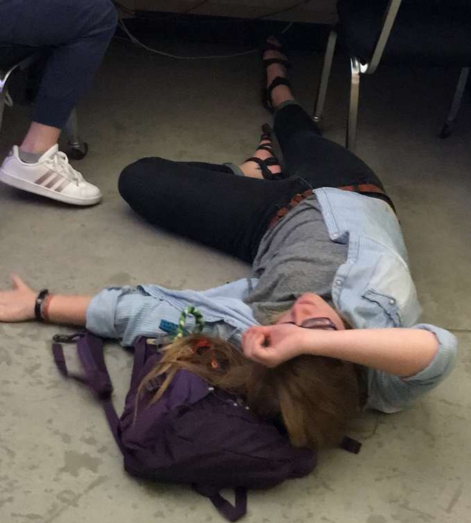 Laying on the floor in journalism class.