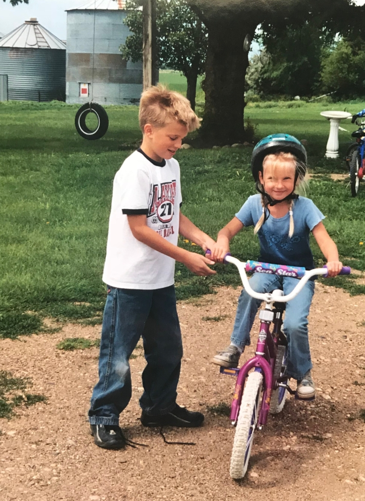 Big brother teaches me how to ride a bike.
