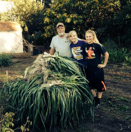 Vern, me and Jill beside our leek harvest. Courtesy of Carol Tolsma.
