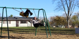 Madison Hetland and Linnea Ankeny swing at McKennan Park.