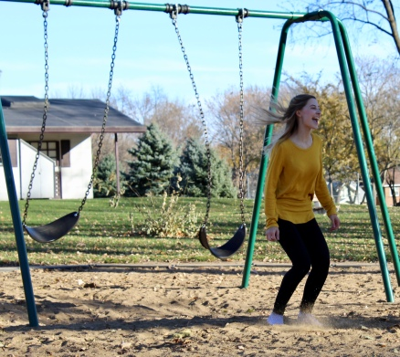 Madison Hetland lands in the sand after jumping from the swing.