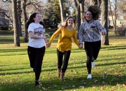 Augustana freshmen Maddy Deetz, Madison Hetland and Linnea Ankeny run through McKennan Park.
