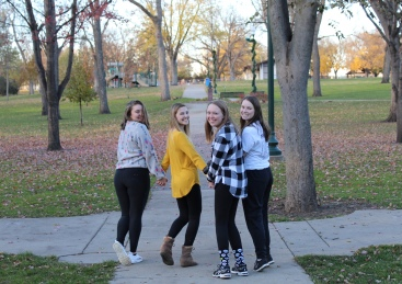 Augustana students Linnea Ankeny, Madison Hetland, Keeley Meier and Maddy Deetz look back as they leave McKennan Park.