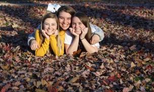 Madison Hetland, Linnea Ankeny and Maddy Deetz enjoy the fall weather at McKennan Park.