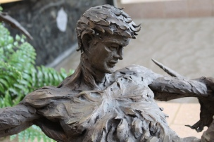 A close-up of the Icarus statue in the Humanities atrium.