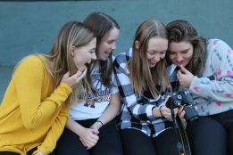 Augustana students Madison Hetland, Maddy Deetz, Keeley Meier and Linnea Ankeny check out a photo on Meier's camera.